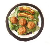 Sausages and Meatballs. Some fresh sausages and meatballs on salad Stock Photography