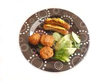 Sausages and Meatballs. Some fresh sausages and meatballs on salad Royalty Free Stock Image