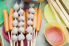 Sausages and meatballs on wooden sticks for barbeque party stock photo