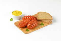 Sausages, mustard and bread Royalty Free Stock Photo