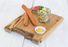 Sausages with mustard and potato salad Stock Photos
