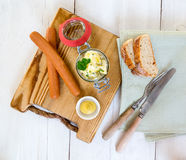Sausages with mustard and potato salad Stock Photo
