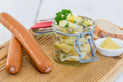 Sausages with mustard and potato salad Royalty Free Stock Image