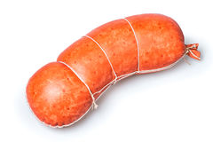 Sausages in natural casing. Boiled sausage in a natural casing on a white background Royalty Free Stock Image