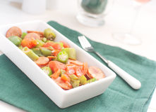 Sausages, okra and tomatoes salad Royalty Free Stock Photos