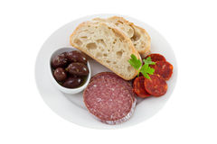 Sausages with olive in oil and bread Royalty Free Stock Photography