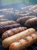 Sausages On Grill, Vertical Stock Photo
