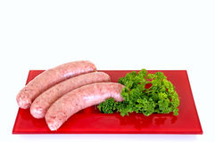 Sausages On Red Plate