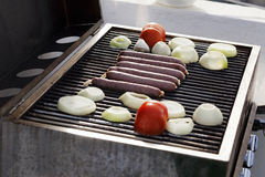 Sausages, Tomatoes & Onions on the Grill Stock Photography