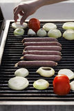 Sausages, Tomatoes & Onions on the Grill Royalty Free Stock Photography