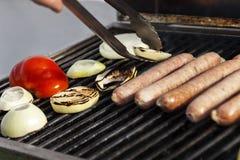 Lifting a Sausage Royalty Free Stock Image