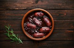 Sausages with onion on wooden background Royalty Free Stock Image