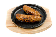 Sausages at pan with sauce Royalty Free Stock Photo