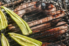 Sausages and peppers on grill Royalty Free Stock Photos