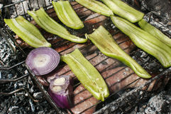 Sausages and peppers on grill Stock Image