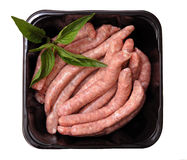 Sausages in plastic tray Stock Photo
