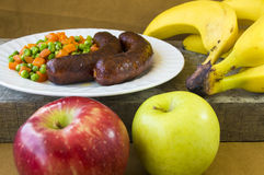 Sausages on a plate and fruits Stock Photo