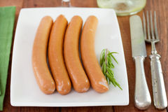 Sausages on the plate. With rosemary Royalty Free Stock Images
