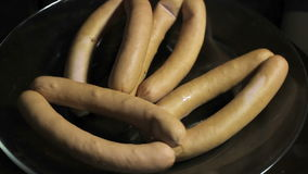 Sausages on a plate stock video footage