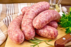 Sausages pork on board with knife Royalty Free Stock Photos
