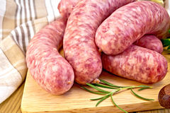 Sausages pork on board with napkin Stock Photo