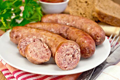 Sausages pork fried in plate on board with parsley Stock Images