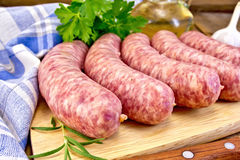 Sausages pork with rosemary on board Royalty Free Stock Photography