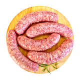 Sausages pork with rosemary on round board Stock Photography