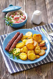 Sausages with potato. And fresh salad Royalty Free Stock Photos