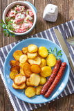 Sausages with potato Stock Images