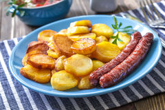 Sausages with potato Stock Photo