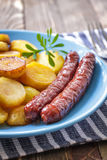 Sausages with potato Royalty Free Stock Photos