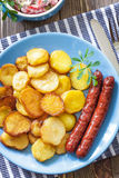 Sausages with potato Royalty Free Stock Image