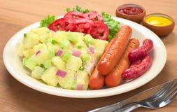 Sausages and Potato Salad Royalty Free Stock Photos