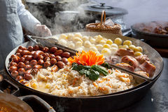 Sausages, potatoes, cabages and pork in big pan Stock Photography