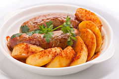 Sausages and potatoes. Stock Photos