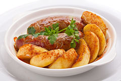 Sausages and potatoes. Royalty Free Stock Image