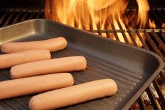 Sausages put on the grill pan Royalty Free Stock Photos
