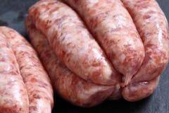 Sausages raw slate Stock Photo