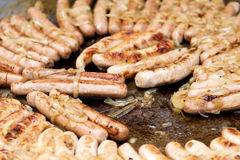 Sausages ready to eat. Sausages with onion ready to eat Stock Photography
