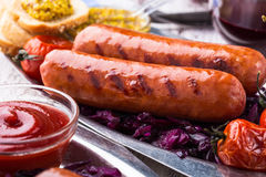 Sausages with red cabbage slaw Stock Photo