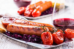 Sausages with red cabbage slaw Stock Images