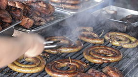 Sausages roast on the grill traditional with fire smoke stock footage
