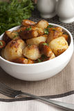 Sausages with roast potatoes Stock Image