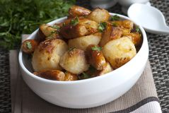 Sausages with roast potatoes Royalty Free Stock Photography