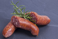 Sausages on roof slate Stock Image