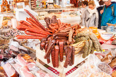 Sausages, salamies and meat for sale on a market on Alter Markt Stock Images