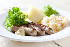 Sausages with sauerkraut Royalty Free Stock Image