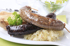 Sausages, sauerkraut and baked potato Royalty Free Stock Images