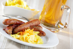Sausages with sauerkraut and beer royalty free stock photos